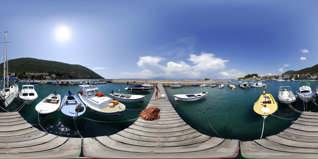 A warped view of a dock with boats